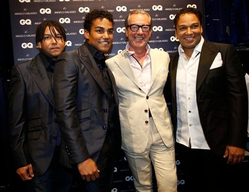 3T pop group members from left, Taj, TJ and Taryll, nephews of late pop star Michael Jackson pose with Italian fashion designer Angelo Galasso as they attend a presentation of Angelo Galasso men's Spring-Summer 2015 collection June 23.(AP Photo/Luca Bruno
