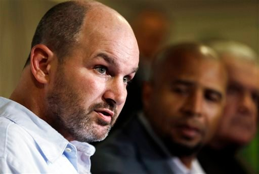 FILE - In this April 9, 2013 file photo, former NFL player Kevin Turner, left, speaks during a news conference in Philadelphia, as former players Dorsey Levens, center, and Bill Bergey listen. (AP)