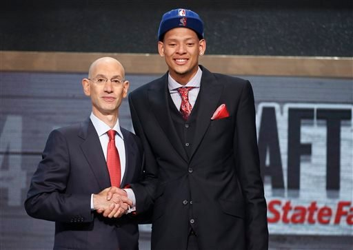 Baylor center Isaiah Austin, right, poses for a photo with NBA Commissioner Adam Silver after being granted ceremonial first round pick during the 2014 NBA draft, Thursday, June 26, 2014, in New York.