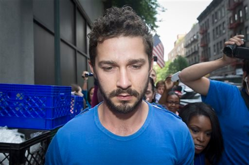 """Actor Shia LaBeouf is followed by media after leaving Midtown Community Court following his arrest the previous day for yelling obscenities at the Broadway show """"Cabaret,"""" Friday, June 27, 2014, in New York."""