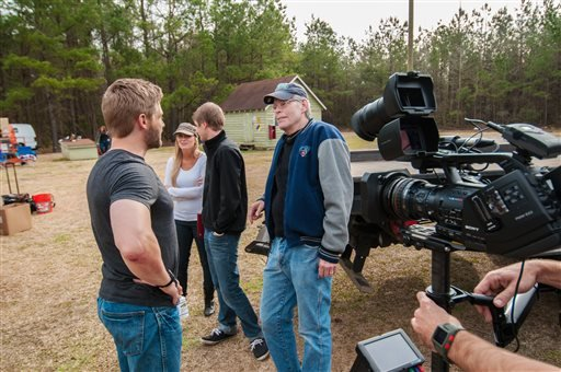 "This photo released by CBS shows, Mike Vogel, left, chatting with Executive Producer Steven King, right, on set for the TV series, ""Under the Dome,"" in Wilmington, N.C."