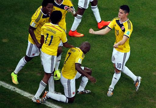 Colombia's James Rodriguez, right, celebrates with his teammates after scoring their side's second goal during the World Cup round of 16 soccer match between Colombia and Uruguay at the Maracana Stadium in Rio de Janeiro, Brazil, Saturday, June 28, 2014.