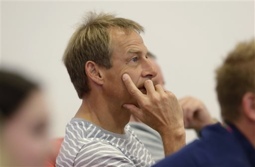 U.S. coach Jurgen Klinsmann watches a match between Brazil and Chile before a training session in Sao Paulo, Brazil, Saturday, June 28, 2014. The United States will play Belgium on Tuesday, in the round of 16 of soccer's World Cup. (AP Photo/Julio Cortez)
