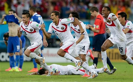 Costa Rica players react after Michael Umana scored during a shootout after regulation time in the World Cup round of 16 soccer match between Costa Rica and Greece at the Arena Pernambuco in Recife, Brazil, Sunday, June 29, 2014.