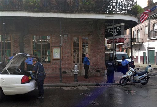 Authorities continue working the scene along Bourbon Street after a shooting, early Sunday, June 29, 2014, in New Orleans.