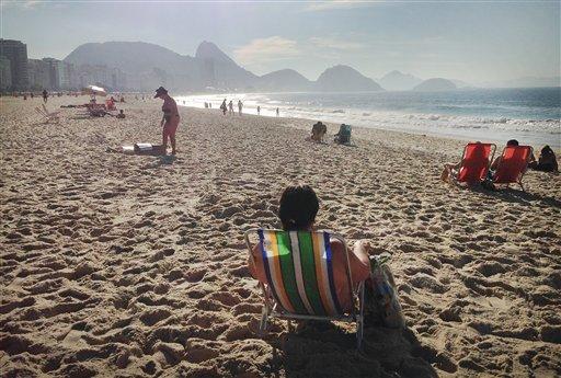People sunbathe, rest, and relax on the Copacabana beach in Rio de Janeiro, Brazil, Wednesday, June 25, 2014.