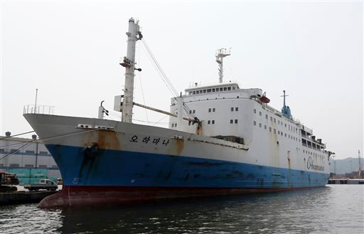 In this June 19, 2014 photo, Ohamana, a Chonghaejin Marine Co., car ferry that plied the same route as the sunken Sewol, drops anchor at Incehon port, South Korea.