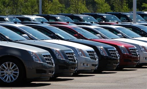 File-This July 14, 2010, file photo shows Cadillac CTS vehicles being displayed outside the LaFountaine Cadillac in Highland Township, Mich. (AP)