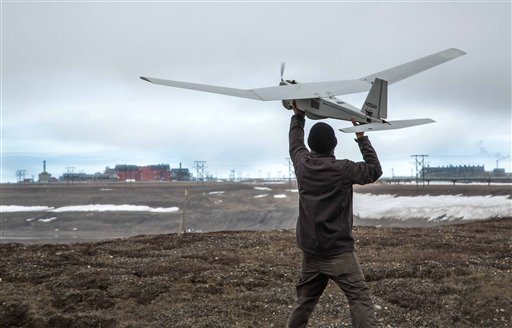 In this photo June 7, 2014, photo released by BP Alaska, Unmanned Aerial System (UAS) technology using an AeroVironment Puma drone is given a pre-flight checkout in preparation for flights by BP at its Prudhoe Bay, Alaska operations. (AP)