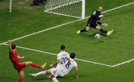 United States' goalkeeper Tim Howard, right, deflects a shot by Belgium's Jan Vertonghen during the World Cup round of 16 soccer match between Belgium and the USA at the Arena Fonte Nova in Salvador, Brazil, Tuesday, July 1, 2014. (AP Photo/Themba Hadebe)