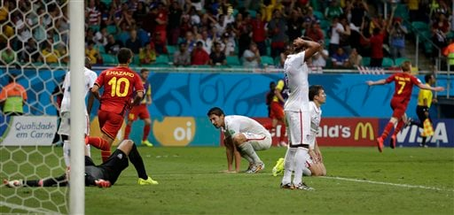 US players react after Belgium's Kevin De Bruyne, right, scored the opening goal during the World Cup round of 16 soccer match between Belgium and the USA at the Arena Fonte Nova in Salvador, Brazil, Tuesday, July 1, 2014.