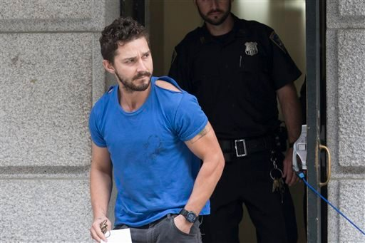 """Actor Shia LaBeouf leaves Midtown Community Court after being arrested the previous day for yelling obscenities at the Broadway show """"Cabaret,"""" Friday, June 27, 2014, in New York. (AP)"""