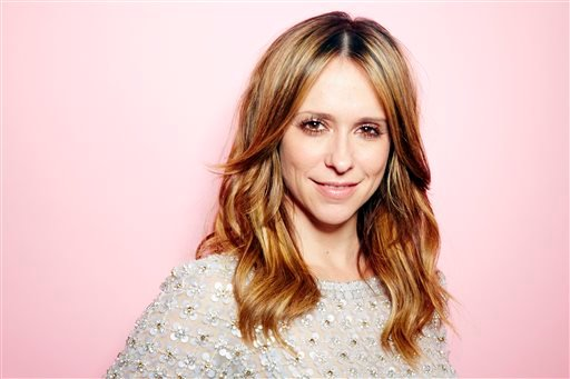 """In this March 4, 2013 file photo, Jennifer Love Hewitt poses for a portrait, in New York. CBS says Hewitt is joining the cast of """"Criminal Minds"""" in fall 2014."""