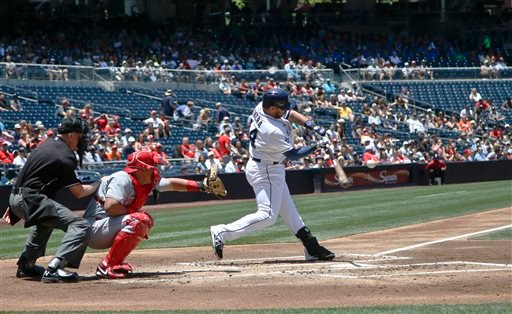 San Diego Padres' Rene Rivera connects for a bloop single with the bases loaded in the first inning of a baseball game against the Cincinnati Reds Wednesday, July 2, 2014, in San Diego.