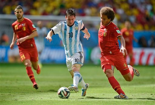 Argentina's Lionel Messi, center, is challenged by Belgium's Axel Witsel, right, during the World Cup quarterfinal soccer match between Argentina and Belgium at the Estadio Nacional in Brasilia, Brazil, Saturday, July 5, 2014. (AP Photo/Martin Meissner)