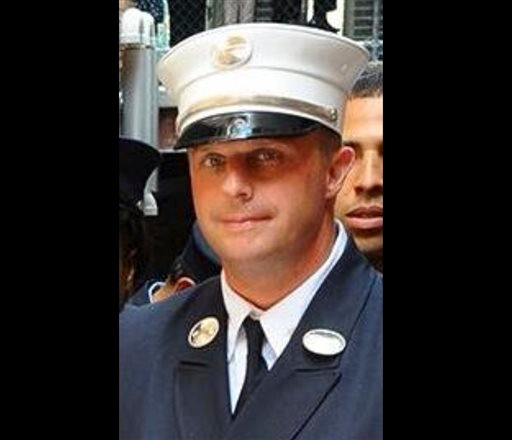 This photo taken on June 26, 2014, and released by the NYFD, shows Lt. Gordon Ambelas, who died at a hospital late Saturday night, July 5, 2014, after battling a blaze that broke out on an upper floor of a Brooklyn public-housing high-rise in New York.