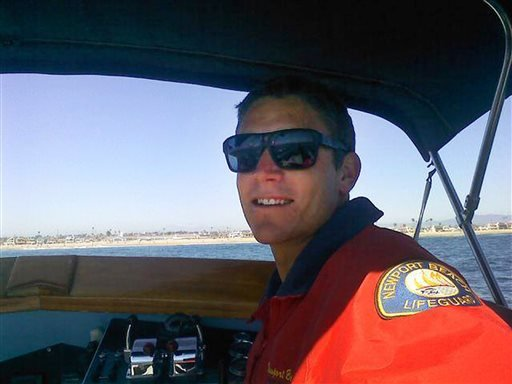 This undated photo provided by the Newport Beach Police Department shows Ben Carlson, 32, a Newport Beach lifeguard who drowned while trying to rescue a swimmer off the Southern California beach on Sunday, July 6, 2014.