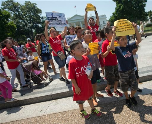 Demonstrators march in front of the White House in Washington, Monday, July 7, 2014. (AP)