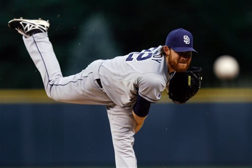San Diego Padres starting pitcher Ian Kennedy throws to the plate against the Colorado Rockies during the first inning of an MLB baseball game on Monday, July 7, 2014, in Denver (AP Photo/Jack Dempsey)
