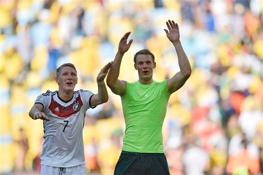 Germany's Bastian Schweinsteiger, left, and goalkeeper Manuel Neuer celebrate at the end of the World Cup quarterfinal soccer match between Germany and France at the Maracana Stadium in Rio de Janeiro, Brazil, Friday, July 4, 2014.