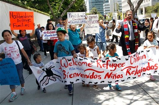 Immigrant families and children's advocates rally in response to President Barack Obama's statement on the crisis of unaccompanied children and families illegally entering the United States, outside the Los Angeles Federal building Monday, July 7, 2014.
