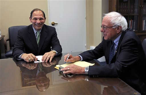 Robert McDonald, left, President Obama's nominee to be secretary of the Department of Veterans Affairs, meets with Senate Veterans' Affairs Committee Chairman Sen. Bernie Sanders, I-Vt., right, on Capitol Hill in Washington, Tuesday, July 8, 2014. (AP)