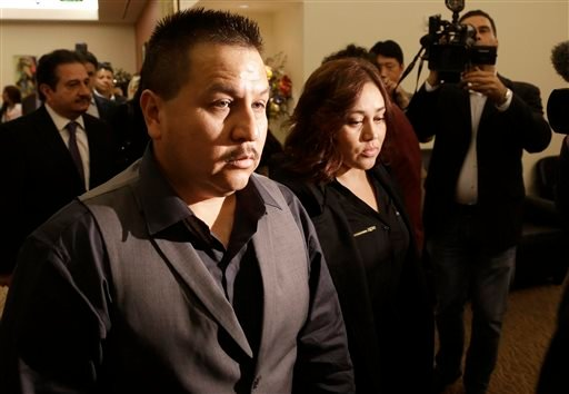 File - This Nov. 4, 2013 file photo shows Rodrigo Lopez, left, and Sujay Cruz, parents of Andy Lopez, as they walk to a news conference in San Francisco. (AP)