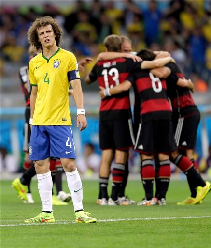 Brazil's David Luiz (4) reacts after Germany's Sami Khedira scored his side's fifth goal during the World Cup semifinal soccer match between Brazil and Germany at the Mineirao Stadium in Belo Horizonte, Brazil, Tuesday, July 8, 2014.
