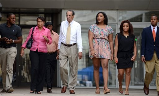 Family members of former New Orleans Mayor Ray Nagin, including his father Clarence Ray Nagin, Sr., center, leave federal court after the former mayor's sentencing in New Orleans, Wednesday, July 9, 2014. (AP Photo/Andrea Mabry)