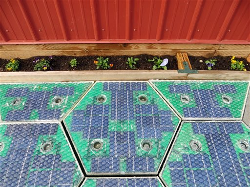 In this May 2014, photo provided by Solar Roadways, a prototype solar-panel parking area stands at the company's business in Sandpoint, Idaho.