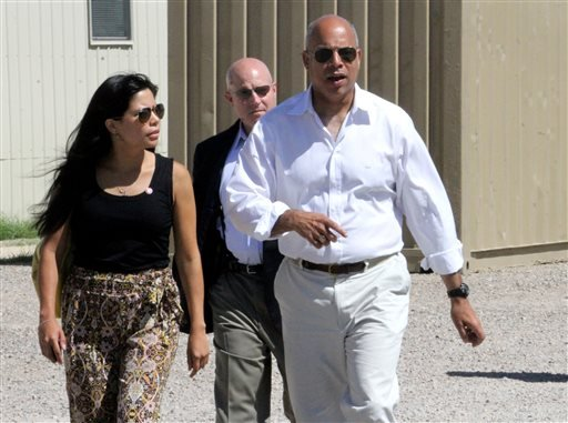 Department of Homeland Security director Jeh Johnson, right, walks to a podium after finishing a tour of the Residential Detention Facility inside the Federal Law Enforcement Training Center in Artesia, N.M. on Friday, July 11, 2014. (AP)