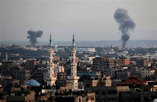 Columns of smoke rise following Israeli strikes on Gaza Strip, Saturday, July 12, 2014.