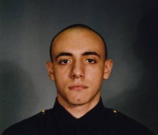 This photo provided by the Jersey City Mayor's office shows Officer Melvin Santiago.