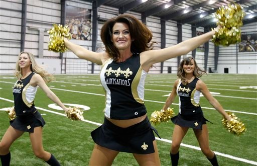 New Orleans Saints Saintsation Kriste Lewis performs during a photo shoot at the NFL football team's training facility in Metairie, La., Wednesday, July 16, 2014. (AP)