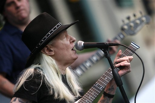 In this Friday, June 19, 2009 file photo, Johnny Winter plays during the Canton Blues Festival 2009 in downtown Canton, Ohio. (AP Photo/The Repository, Bob Rossiter)