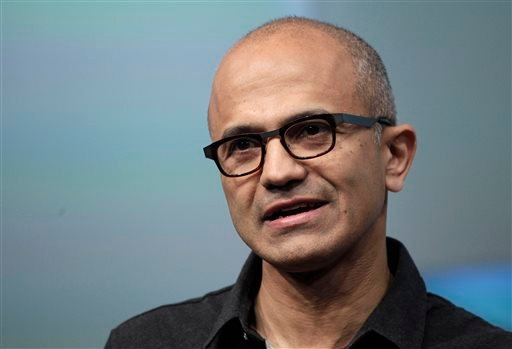 Satya Nadella, CEO of Microsoft, talks during the introduction the Surface Pro 3 tablet device at a media preview in New York. Microsoft on Thursday, July 17, 2014 announced it will lay off up to 18,000 workers over the next year. (AP Photo/Mark Lennihan,