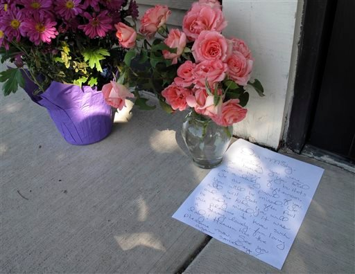 July 16, 2014 image provided by the Stockton Police Depart shows a condolence letter written for Misty Holt-Singh, who was married with children, one of the victims of a bank robbery July 16, 2014. (AP Photo/Stockton Police Department)