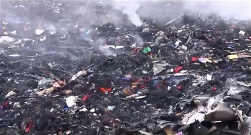 In this image taken from video, Thursday July 17, 2014, showing debris at the crash site after a passenger plane carrying 295 people was shot down Thursday as it flew over Ukraine, near the village of Hrabove, in eastern Ukraine. (AP)