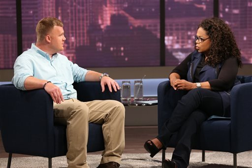 This June 27, 2014 image released by OWN shows Matt Sandusky, the adopted son of former Penn State University assistant football coach Jerry Sandusky, during an interview with Oprah Winfrey, airing on OWN on Thursday, July 17.