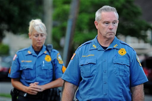 Waldwick Sgt. Jodi Zuzeck and Waldwick Police Chief Mark Messner attend a news conference Thursday, July 17, 2014, in Waldwick, N.J. (AP Photo/Northjersey.com, Amy Newman)