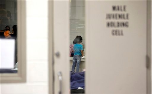 FILE - This June 18, 2014 file-pool photo shows detainees in a holding cell at a U.S. Customs and Border Protection processing facility in Brownsville, Texas. (AP Photo/Eric Gay, Pool, File)