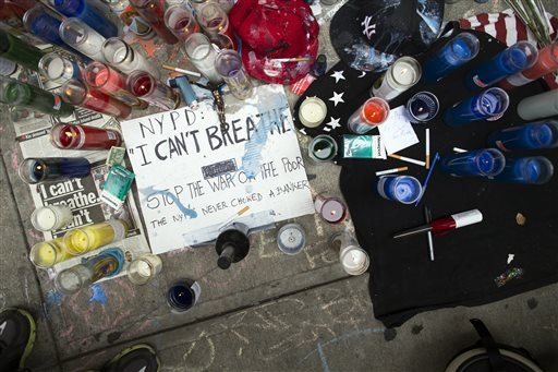A memorial for Eric Garner rests on the pavement near the site of his death, Saturday, July 19, 2014, in the Staten Island borough of New York.