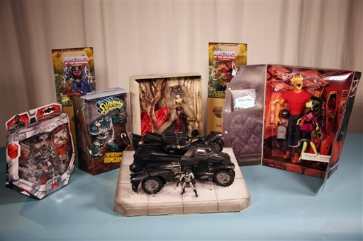 This Friday, July 18, 2014 photo shows exclusive, collectible toys available from Mattel at 2014 Comic-Con, in San Diego.