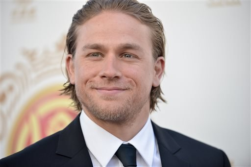In this June 1, 2014 file photo, Charlie Hunnam arrives at the Huading Film Awards in Los Angeles.