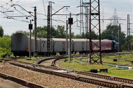 A refrigerated train loaded with bodies of the passengers of Malaysian Airlines flight MH17 departs Kharkiv railway station, Ukraine, Tuesday, July 22, 2014.