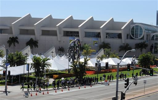 In this July 17, 2013 file photo, fans walk past the Hall H line-up area outside the San Diego Convention Center as they head to the Preview Night event on Day 1 of the 2013 Comic-Con International Convention in San Diego.