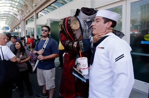 In this July 19, 2013 file photo, Navy Mineman Bradley Allred jokes as he has his picture taken with a headless character during Comic-Con, in San Diego.