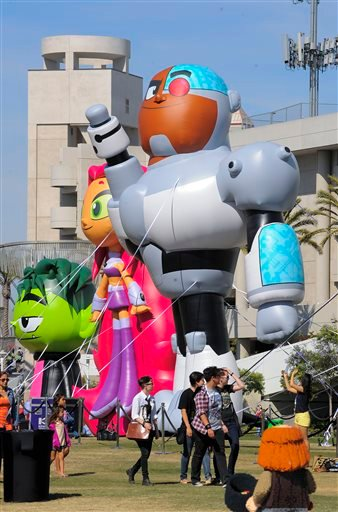 In this July 17, 2013 file photo, fans walks past blow up Team Titans figures outside the San Diego Convention Center as they head to the Preview Night event on Day 1 of the 2013 Comic-Con International Convention, in San Diego.