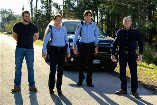"""This photo released by CBS shows, from left, Mike Vogel as Dale """"Barbie"""" Barbara, Natalie Martinez as Deputy Linda Esquivel, Alexander Koch as Junior Rennie, and Dean Norris as James """"Big Jim"""" Rennie, in the second season premiere of """"Under the Dome."""" AP"""
