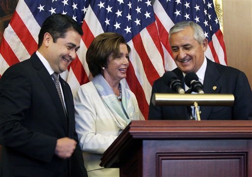 House Democratic Leader Nancy Pelosi, D-Calif., center, is seen with Guatemalan President Otto Molina, right, and Honduran President Juan Hernández on Thursday, July 24, 2014 on Capitol Hill in Washington.